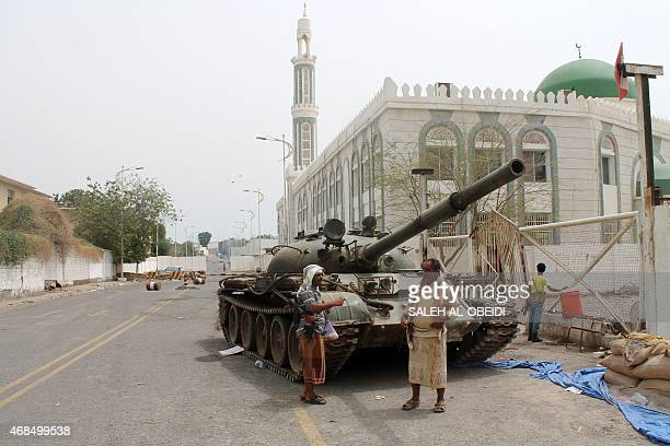 Armed Yemeni supporters of the separatist Southern Movement stand next to a tank on April 3 2015 in the Tawahi district of the the southern Yemeni...