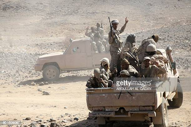 Armed Yemeni tribesmen from the Popular Resistance Committees supporting forces loyal to Yemen's Saudibacked President Abedrabbo Mansour Hadi drive...