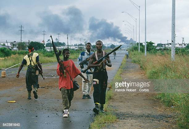 Armed young men patrol a road in Monrovia during the Liberian Civil War In 1989 Charles Taylor leader of the NPFL launched a revolt against the...