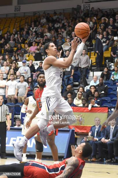 Armel Potter of the George Washington Colonials drives to the basket during a college basketball game against the Stony Brook Seawolves at the Smith...