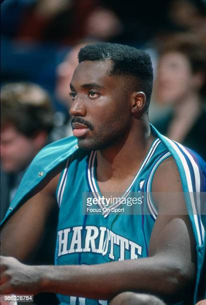 Armen Gilliam of the Charlotte Hornets looks on from the bench against the Washington Bullets during an NBA basketball game circa 1991 at the Capital...