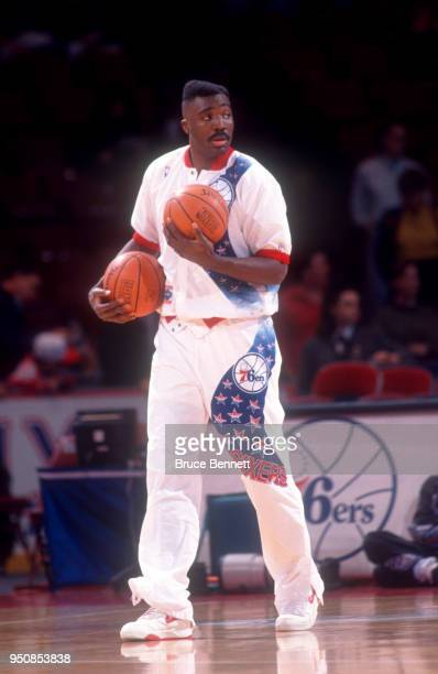 Armen Gilliam of the Philadelphia 76ers holds the ball during warmups prior to an NBA game against the Chicago Bulls on March 8 1992 at the Spectrum...