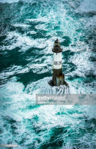 armen lighthouse isolated in the storm - extreme weather stock photos and pictures