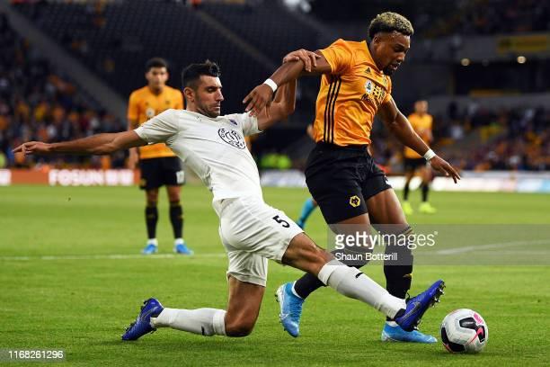 Armen Manucharyan of FC Pyunik tackles Adama Traore of Wolverhampton Wanderers during the UEFA Europa League Third Qualifying Round Second Leg...