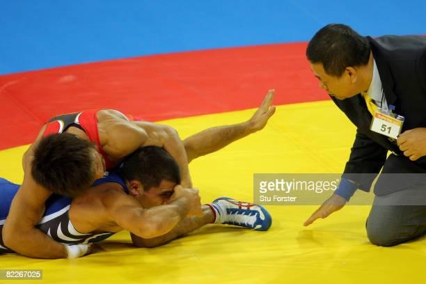 Armen Nazarian of Bulgaria looks towards the referee as he competes against Makoto Sasamoto of Japan in their Men's GrecoRoman 60 kg quarterfinal...