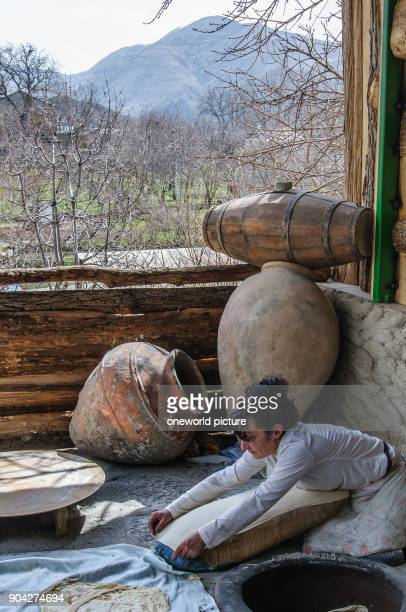 Armenia Kotayk Province Garni Lavash is the typical Armenian bread A waferthin dough is glued to the inside of a woodfired stone oven The parallels...