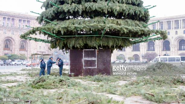 Armenia Yerevan Yerevan Republic Square in midDecember a large Christmas tree guarded by policemen is placed on the central square