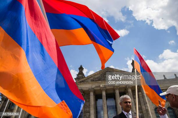Armenian activists wave flags outside the Bundestag after law makers voted to recognise the Armenian genocide after a debate during the 173rd sitting...