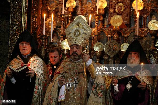 Armenian Archbishop Nurhan Menugian conducts the traditional washing of the feet ceremony at St. James Armenian church in Jerusalem's Old City on...