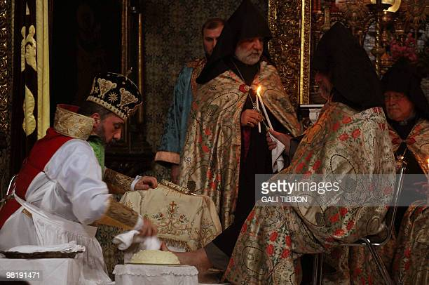 Armenian Archbishop Nurhan Menugian conducts the traditional washing of the feet ceremony at St James Armenian church in Jerusalem's Old City on...