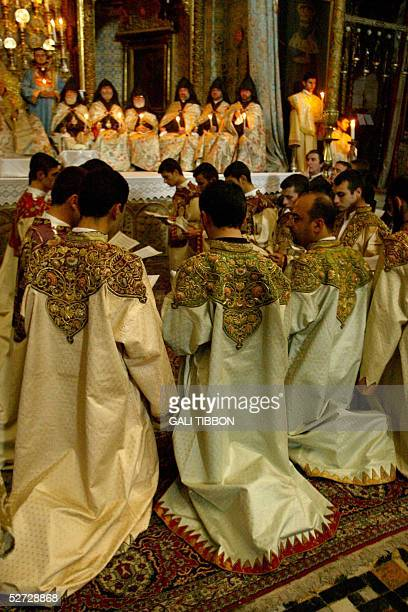 Armenian choirboys take part in the traditional Washing of the Feet ceremony at the Armenian Church in Jerusalem's Old City, 28 April 2005, in...