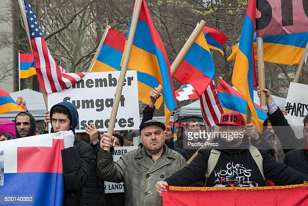 Armenian demonstrators wave flags and hold signs at the rally. Demonstrators from the NYC Metro-area Armenian-American community held a rally in Dag...