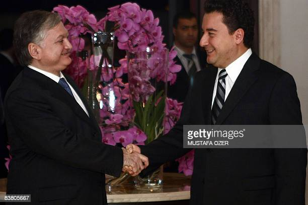 Armenian Foreign Minister Edward Nalbandian shakes hands with his Turkish counterpart Ali Babacan before their meeting in Istanbul on November 24,...