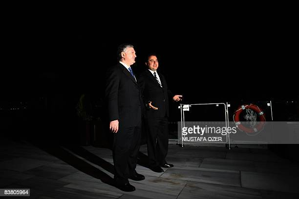 Armenian Foreign Minister Edward Nalbandian talks with his Turkish counterpart Ali Babacan before their meeting in Istanbul, on November 24, 2008....
