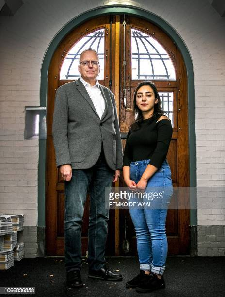 Armenian Hayarpi Tamrazyan and Dutch pastor Theo Hettema pose in the Bethel church in The Hague on October 30 2018 A Dutch church has resorted to the...