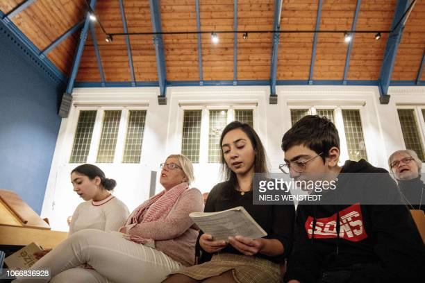 Armenian Hayarpi Tamrazyan and her brother Warduhi during a service in the Bethel church in The Hague on October 30 2018 A Dutch church has resorted...