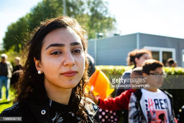 Armenian Hayarpi Tamrazyan looks on during a demonstration against the expulsion of rooted children in the Netherlands on September 26 2018 A Dutch...