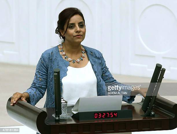 Armenian lawmaker Selina Dogan of the opposition party Republican People's Party takes her oath at the Turkish parliament in Ankara during the...