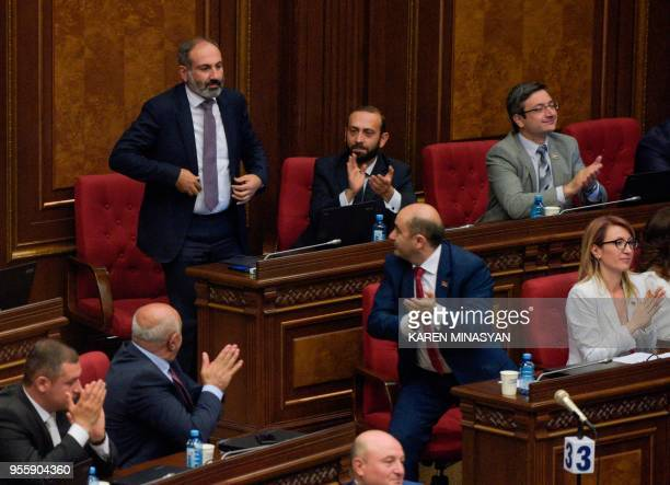 TOPSHOT Armenian opposition leader Nikol Pashinyan reacts after being elected as prime minister during a parliament session in Yerevan on May 8 2018