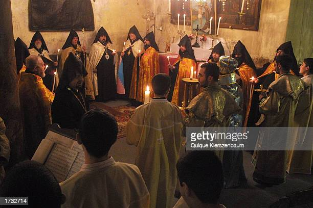 Armenian Orthodox Patriarch of Jerusalem Torkom Manugian leads the noon service in the Church of the Nativity January 18 2003 in the West Bank town...