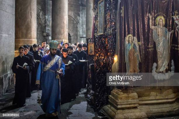 Armenian Orthodox priests take part in a procession to celebrate Easter Sunday at the Church of the Holy Sepulcher in the Old City on April 1 2018 in...