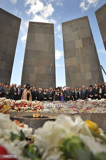 Armenian president Serzh Sarkisian and Armenian Apostolic Church leader Catholicos Garegin II lay flowers at the genocide monument to Armenians...