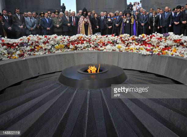 Armenian president Serzh Sarkisian and Armenian Apostolic Church leader Catholicos Garegin II and top officials lay flowers at the genocide monument...