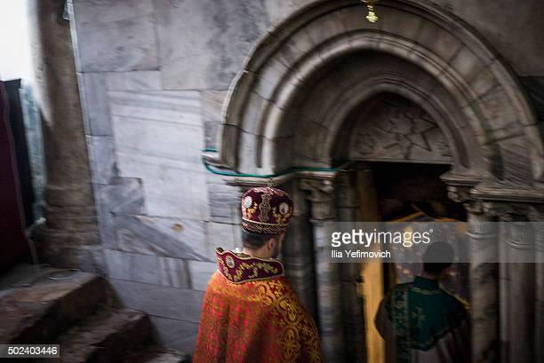 Armenian priest seen at the church of Nativity during a morning mass on December 24 2015 in Bethlehem West Bank Every year thousands of Christian...
