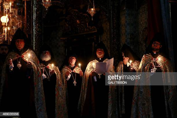 Armenian priests hold candles as theu pray during the traditional Easter Washing of the Feet ceremony at St James Cathedral in Jerusalem's Old City...