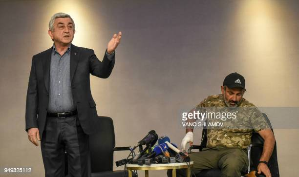 Armenian Prime Minister Serzh Sarkisian gestures during his meeting for televised talks with antigovernment protest leader Nikol Pashinyan in...
