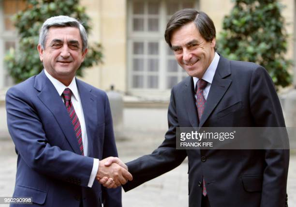 Armenian Prime minister Serzh Sarkisian shakes hands with counterpart François Fillon upon arrival at the Hotel Matignon the French Premier's...