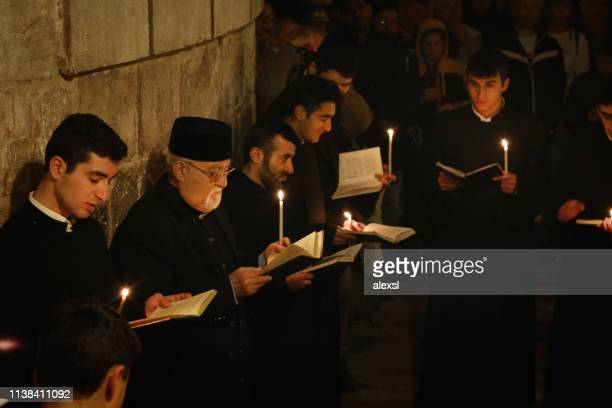armenian procession at the holy sepulchre church jerusalem old city - place of worship stock pictures, royalty-free photos & images