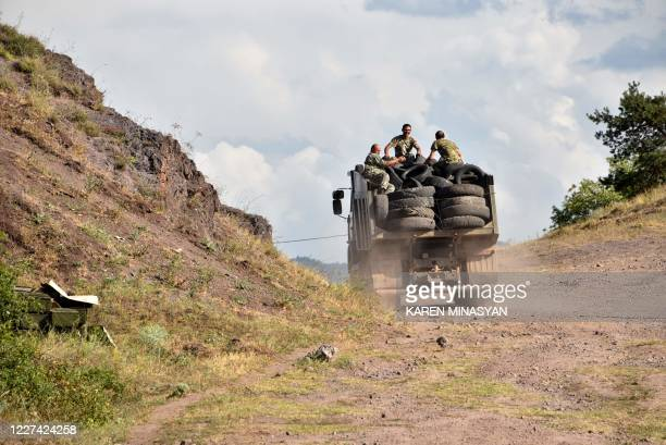 Armenian servicemen transport used tyres in the back of a truck to fortify their positions on the ArmenianAzerbaijani border near the village of...