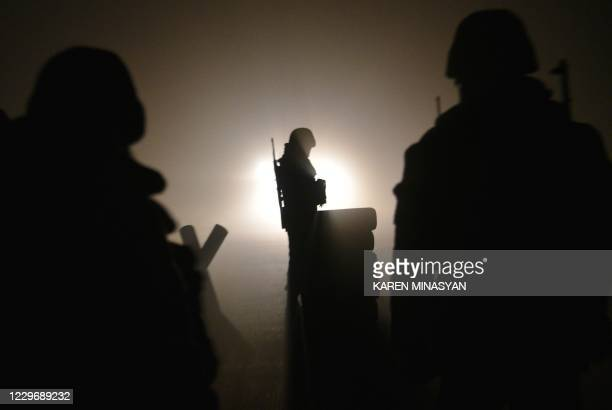 Armenian soldiers patrol at the check point outside Agdam to let last vehicles leave the region late on November 19, 2020 as the territory is due to...