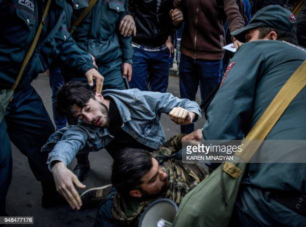 Armenian special police forces detain opposition supporters during an antigovernment rally in front of the entrance of the government headquarters in...