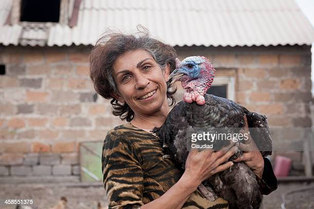 armenian woman holding turkey - armenia stock pictures, royalty-free photos & images