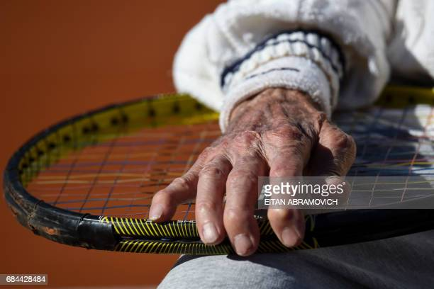 Armenianborn Argentine 100yearold Artyn Elmayan holds his racket as he offers an interview to AFP at the River Plate Club in Buenos Aires on May 16...