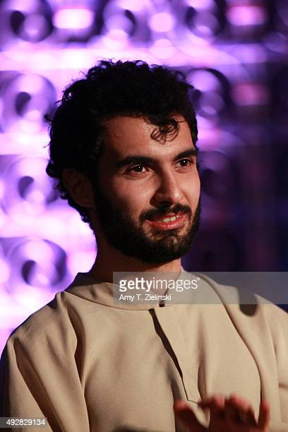 Armenianborn LAbased jazz pianist Tigran Hamasyan receives applauds after performing with members of the Yerevan State Chamber Choir tracks from his...