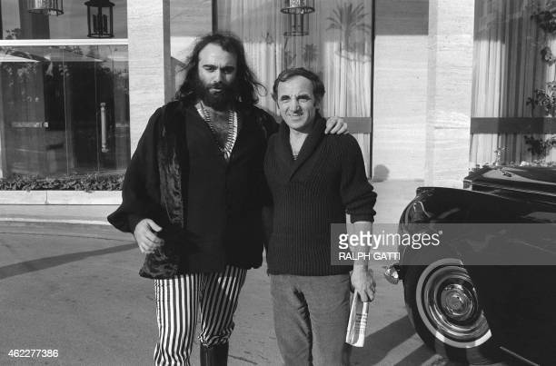 Armenianborn French singer Charles Aznavour poses with Greek singer Demis Roussos on January 26 1973 during the Midem in Cannes on the French Riviera...