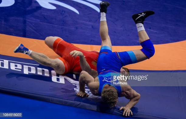 Armenians Aleksanyan Artur and Russians Evloev Musa compete during the semi final of mens Greco Roman 97 kg category at the World Wrestling...