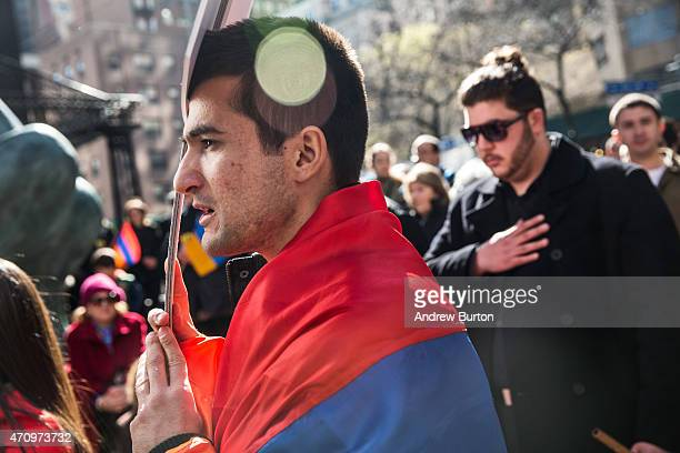 Armenians and supporters gather for a rally after marching through the streets to commemorate the 100th anniversary of the mass killings of Armenians...