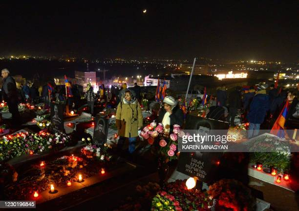 Armenians attend a ceremony to commemorate those who died in wars over Karabakh at the Yerablur Military Memorial Cemetery in Yerevan on December 18,...