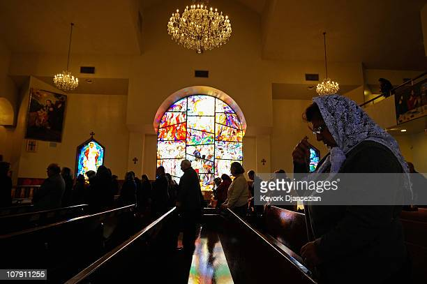 Armenians celebrate Christmas mass at St Garabed Armenian Apostolic Church against the backdrop of a stained glass window on January 6 2011 in Los...