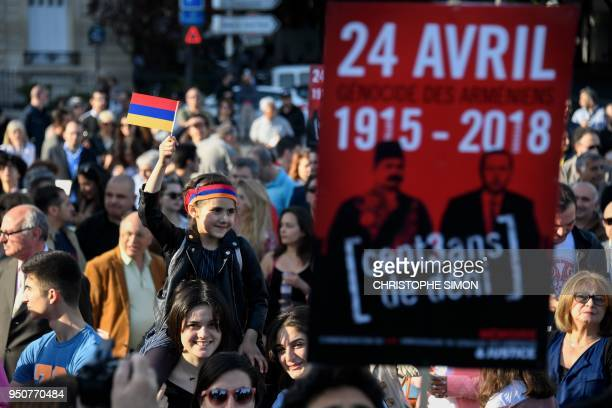 Armenians gather as they commemorate the 103rd anniversary of the Armenian Genocide at the Invalides Bridge in Paris on April 24 2018 April 24 is...