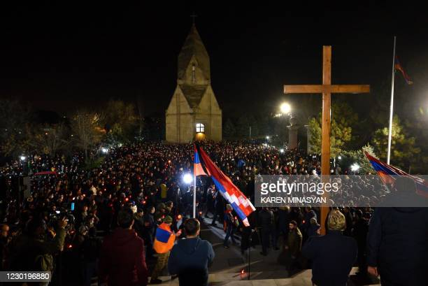 Armenians holding candles attend a ceremony to commemorate those who died in wars over Karabakh at the Yerablur Military Memorial Cemetery in Yerevan...
