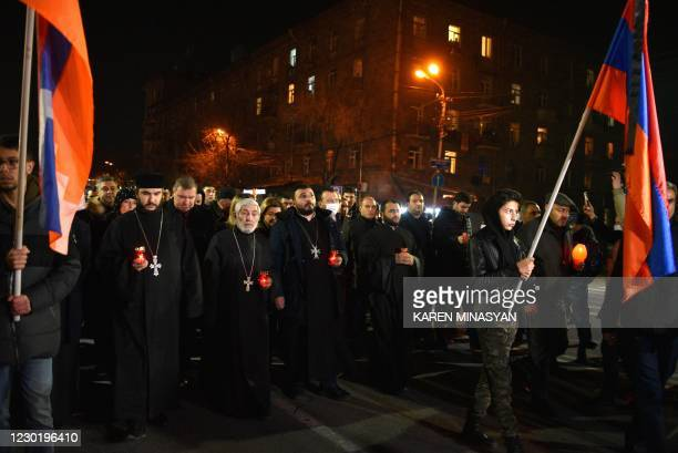 Armenians holding candles march to the Yerablur Military Memorial Cemetery to commemorate those who died in wars over Karabakh, in Yerevan on...