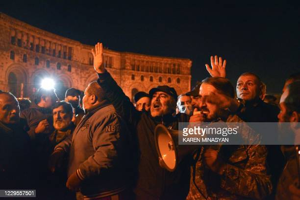 Armenians protest against the country's agreement to end fighting with Azerbaijan over the disputed Nagorno-Karabakh region outside the government...