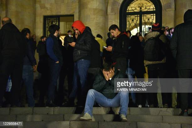 Armenians protest against the country's agreement to end fighting with Azerbaijan over the disputed Nagorno-Karabakh region outside the parliament in...