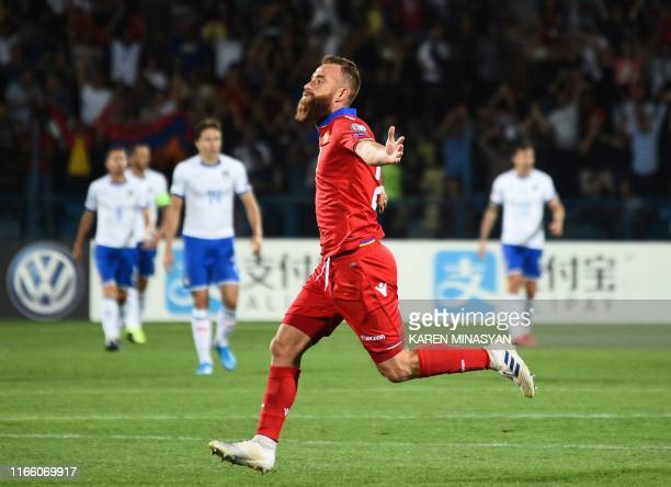 Armenia's forward Aleksandr Karapetyan celebrates after scoring a goal during the Euro 2020 Group J football qualification match between Armenia and...