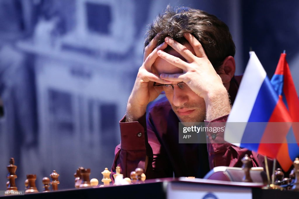 Armenia's Levon Aronian plays during a round 2 game of the Alekhine Memorial chess tournament on April 22, 2013 in Paris. The tournament is a 10-player single round competition, with the first half held in Paris from April 20 to 25, and the second half in the Russian State Museum in St. Petersburg from APril 26 to May 1st.